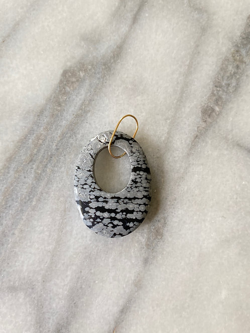 Snowflake Obsidian Charm in 14K yellow gold.