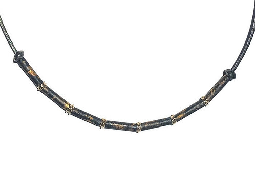 The Maurice Necklace features fine silver round tubes, 24K gold foil and 18K gold rings.