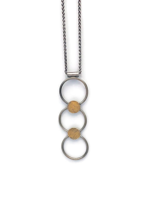 Tri Circle necklace featuring silver and gold.