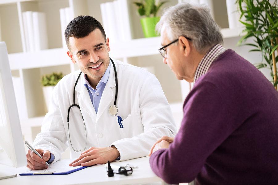 Doctor Explaining Prescription To Senior Patient.jpg