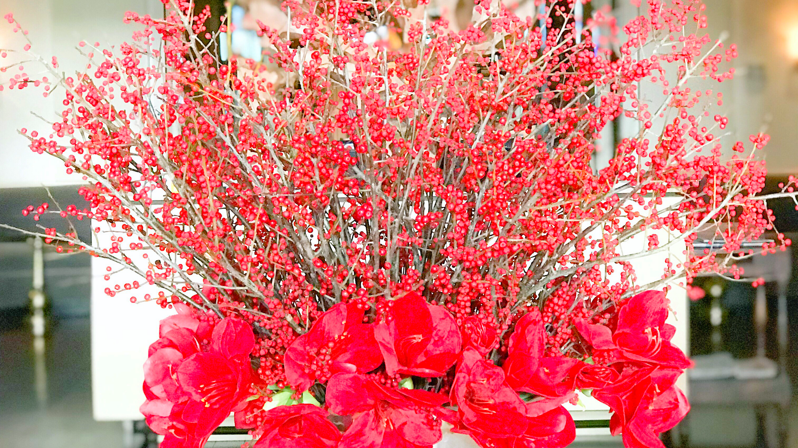 Oversized red berry centerpiece designed by Franzie's Flower Design for the Fairmont Dallas hotel, Pyramid Restaurant & Bar lobby.