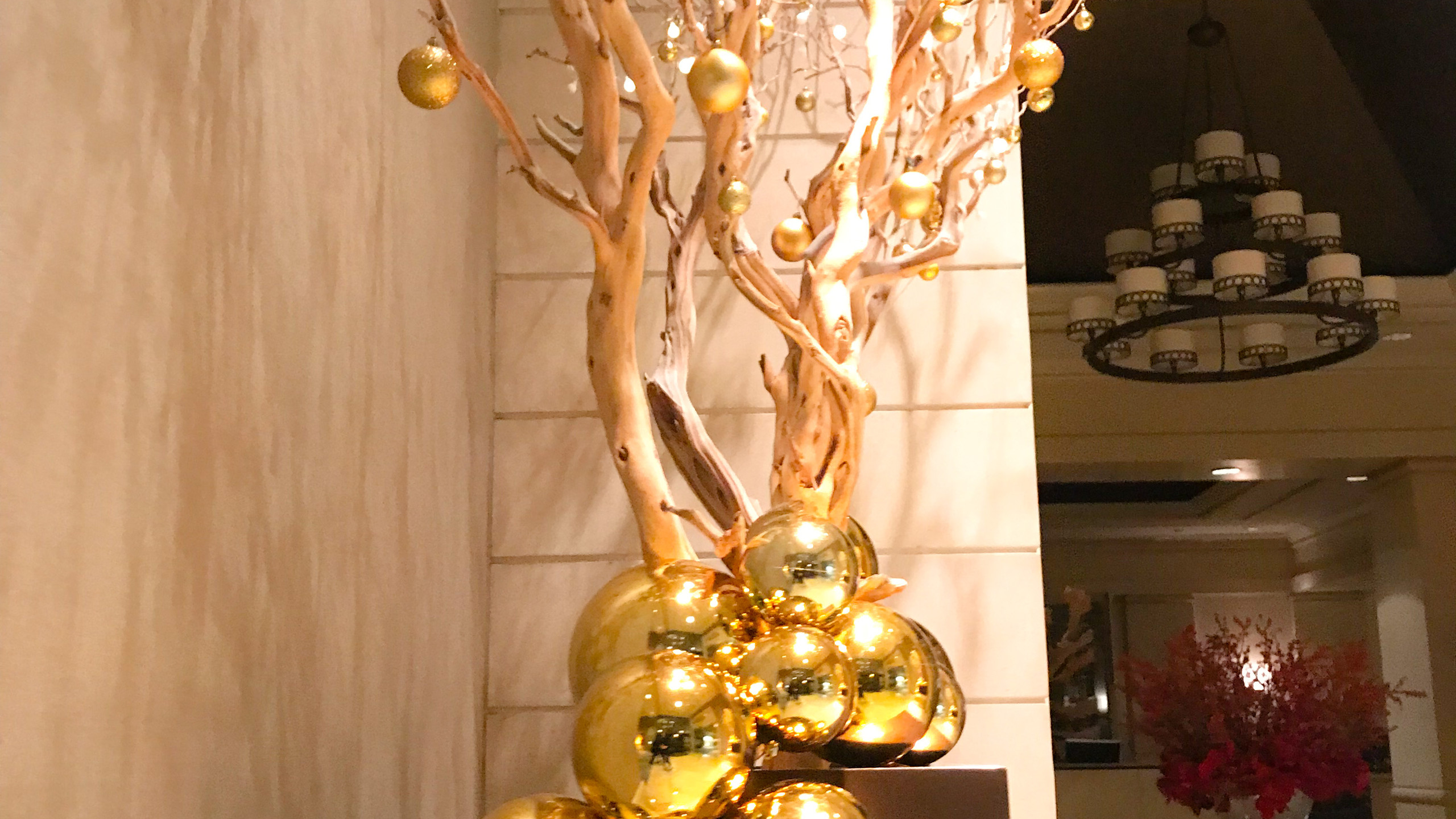 Details of 12 ft' Modern Christmas tree display designed by Franzie's Flower Design for the Fairmont Dallas hotel, Pyramid Restaurant & Bar lobby.