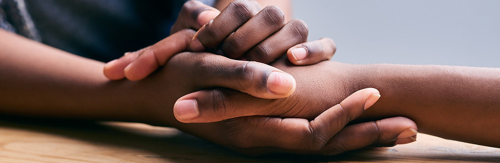 heartlandalliance.org; two hands being held for support
