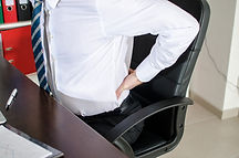 Man having back pain from prolonged sittng