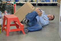 knee injury after worker falls off stool