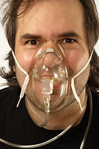 Man wearing a breathing mask when subject to toxic fumes.