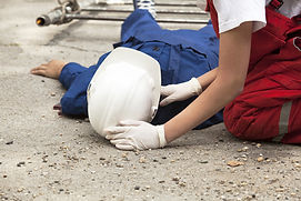 Construction worker fell from unprotected scaffolding onto cement floor causing closed head injury.