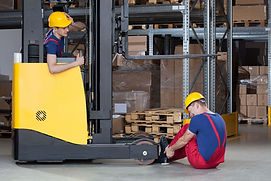 Worker crushes co-workers foot with unguarded forklift causing injury.