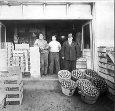 Grandpa Mercurio in front of his first brick and mortar building. Capitol Fruit Company circa 1930