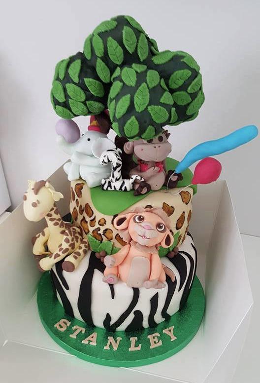 animale themed 1st birthday cake