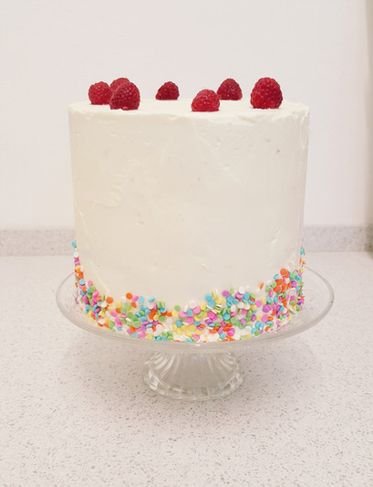 simple buttercream cake with sprinkles