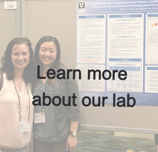 Two women smiling in front of academic poster