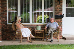 couple-talking-on-front-porch