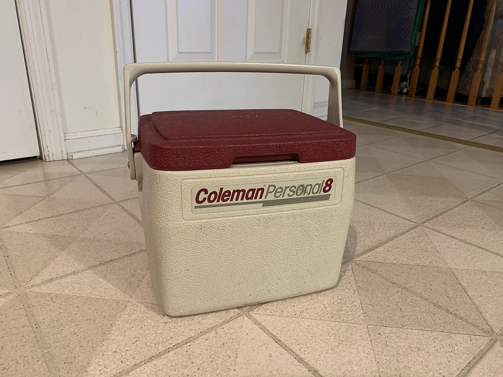 A cooler, essential for managing POFCS when traveling.