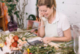 young-woman-working-florist_23-214776101