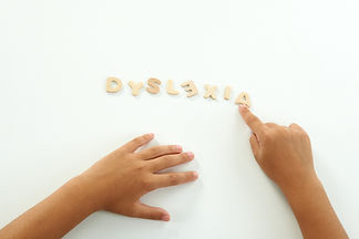 Hands Of A Girl Form The Word Dyslexia W