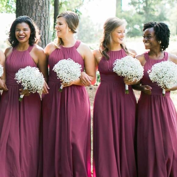 Multi-ethnic Bridesmaids holding baby's breath bouquets wearing burgundy bridesmaids Azazie dresses