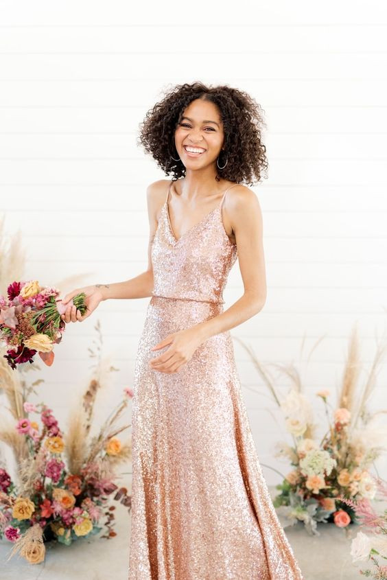 Biracial woman wearing Blush Revelry Sequins Bridesmaids Dress and Pink Bouquet