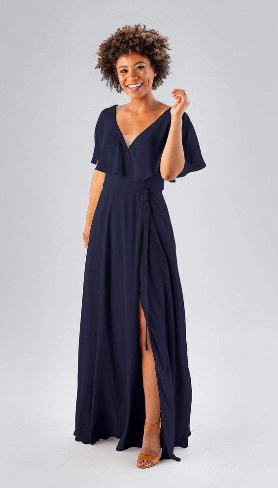 African American woman with natural hair in navy blue Azazie bridesmaids dress