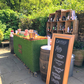 Chin Chin Lawn Bar at Ben & Charlotte's Spring Barn Wedding at Bartholomew Barn, West Sussex
