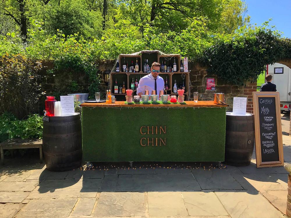 Chin Chin Lawn Bar at Bartholomew Barn courtyard wedding in West Sussex