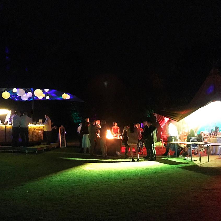Night shot of teepee & Caravan Bar