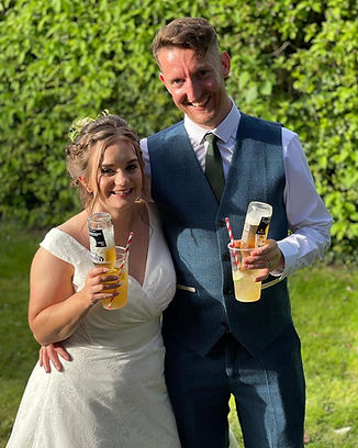 The Bride and Groom, Charlotte & Alastair at their wedding with Lageritas at Lower Hardres