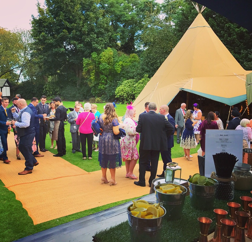 Wedding guests and teepee