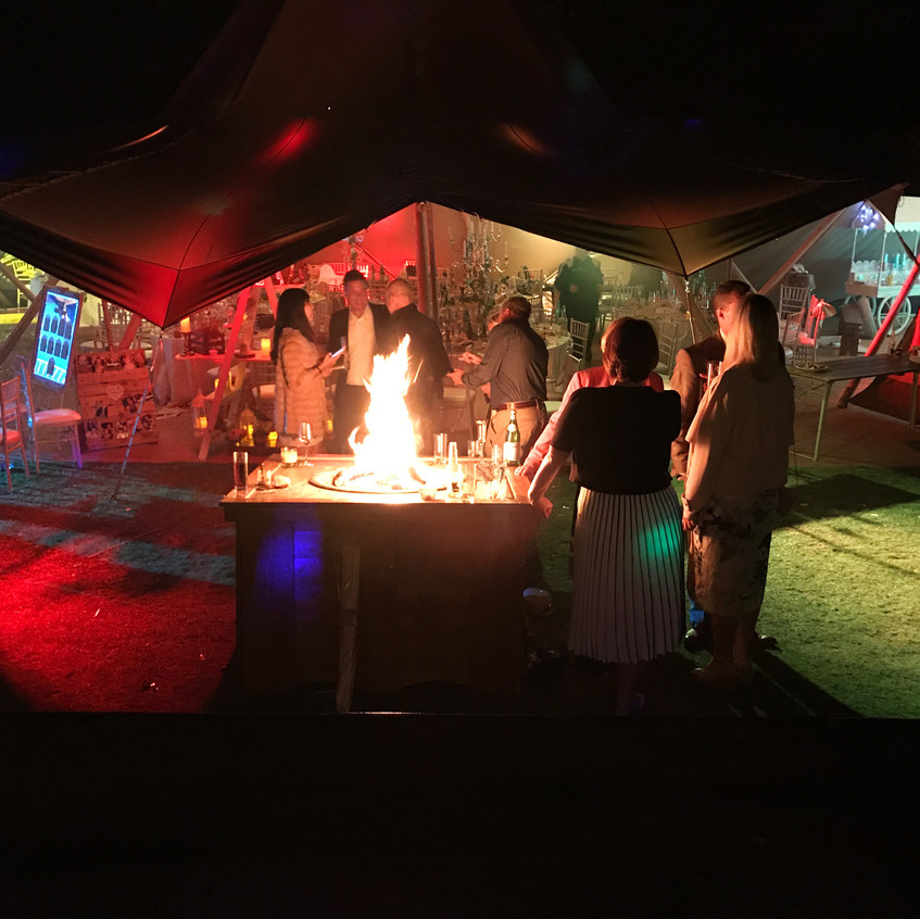 Wedding guests with firepit & teepee