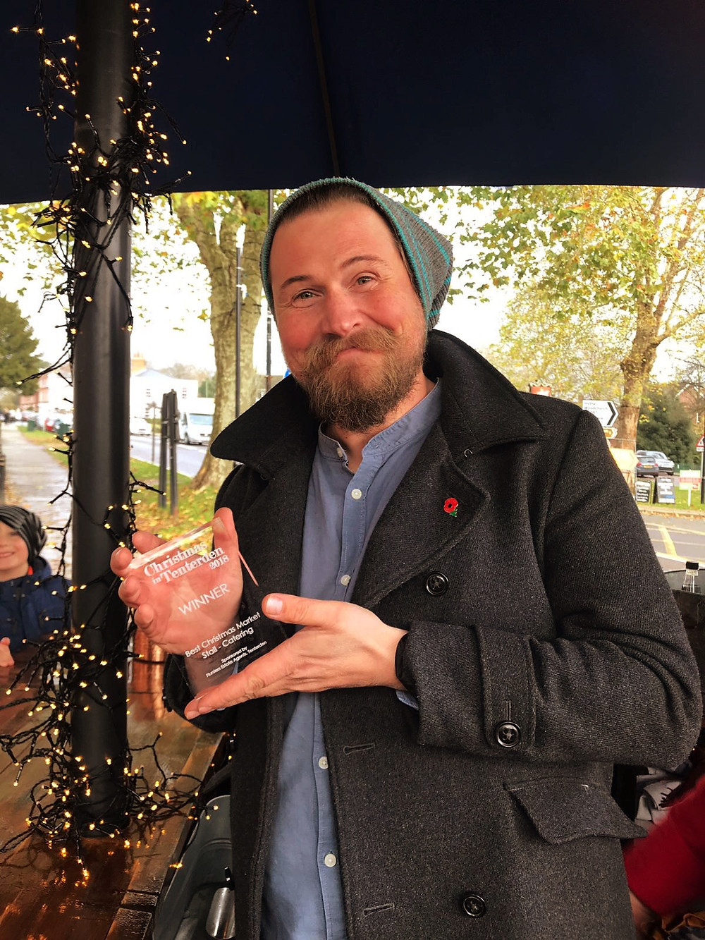 Oliver with the Chin Chin award for Best Christmas Market Catering Stall at Christmas in Tenterden 2018