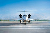 Private jet airplane on airfield, waitin
