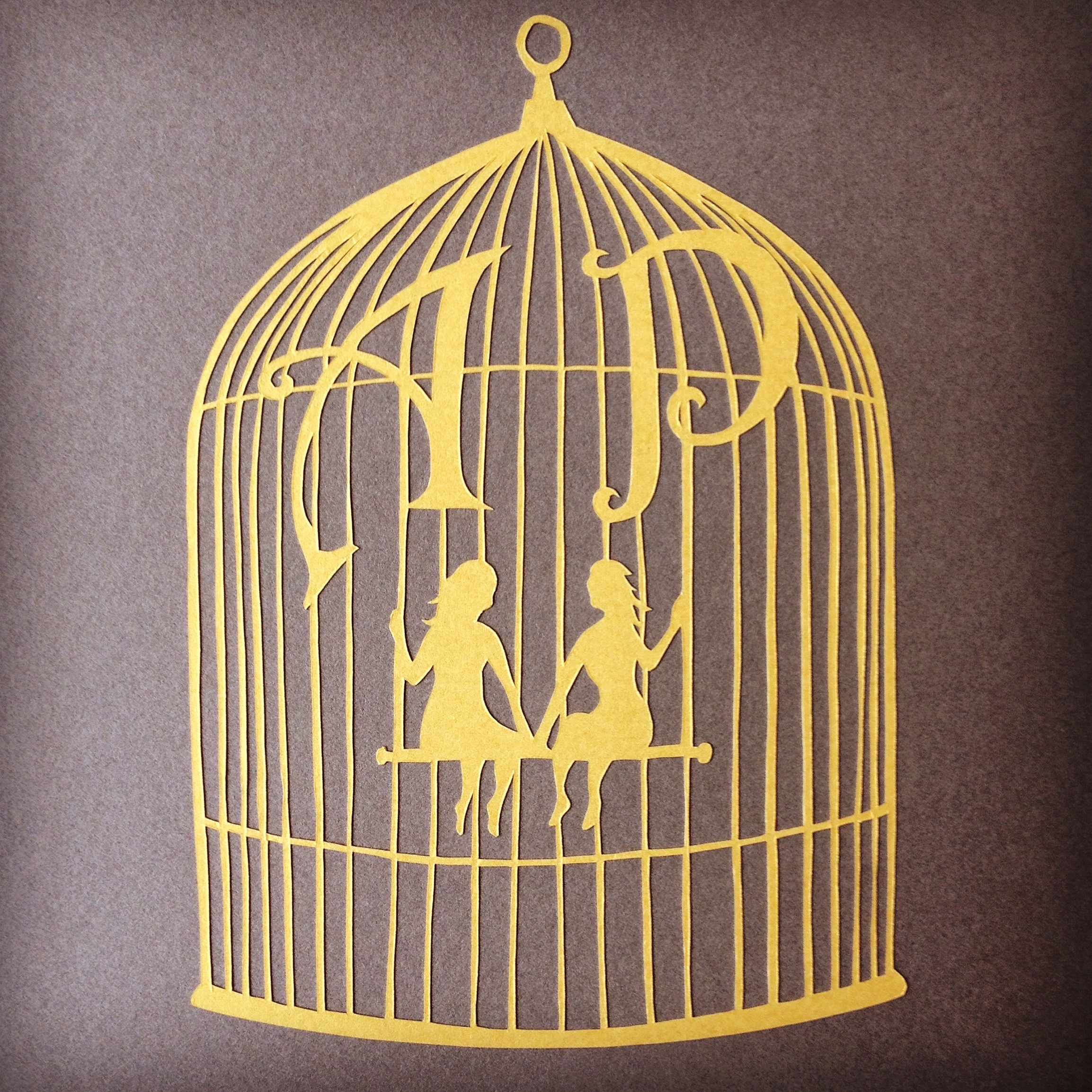 Papercut birdcage with initials