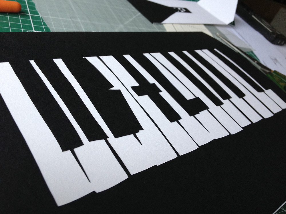 finished papercut piano keyboard wedding card