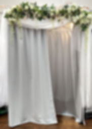 White photo booth with flowing sheer, flowers, and eucalyptus at Crowne Plaza Warwick Rhode Island