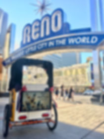 photo of ad screen in front of reno arch