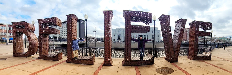 Get Creative in front of the believe sign
