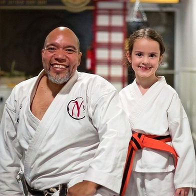Sensei Michael Baez with a female orange belt NC Budo student