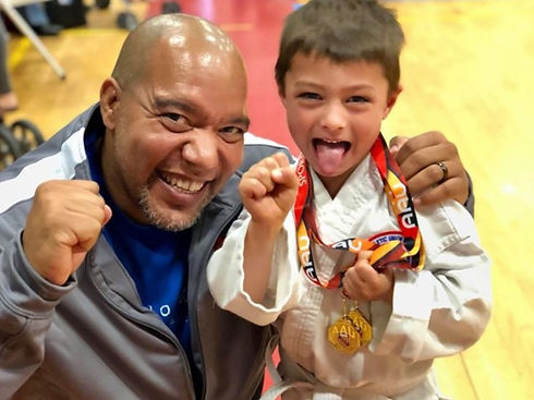 Sensei Michael Baez with a young karate competitor showing off his winning medal