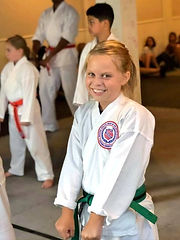 Girl smiling in karate gi during class