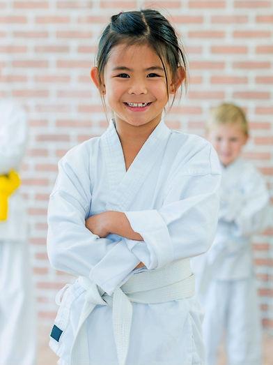 Girl smiling wearing karate gi