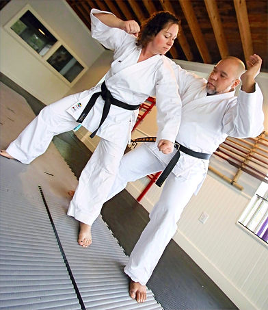 Sensei Jena Hare and Sensei Michael Baez demonstrating karate techniques