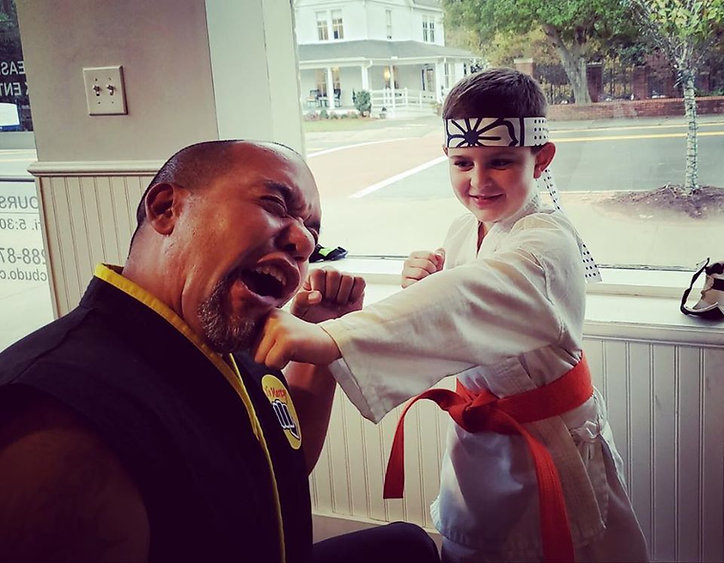 Sensei Michael Baez sparring with a young student