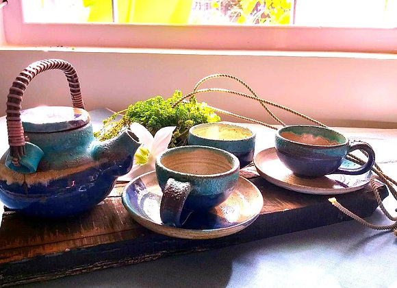 Handmade Ceramic Blue Tea Set with a Tea pot, 2 Cups and Saucers and a Bowl all with a Beige interior