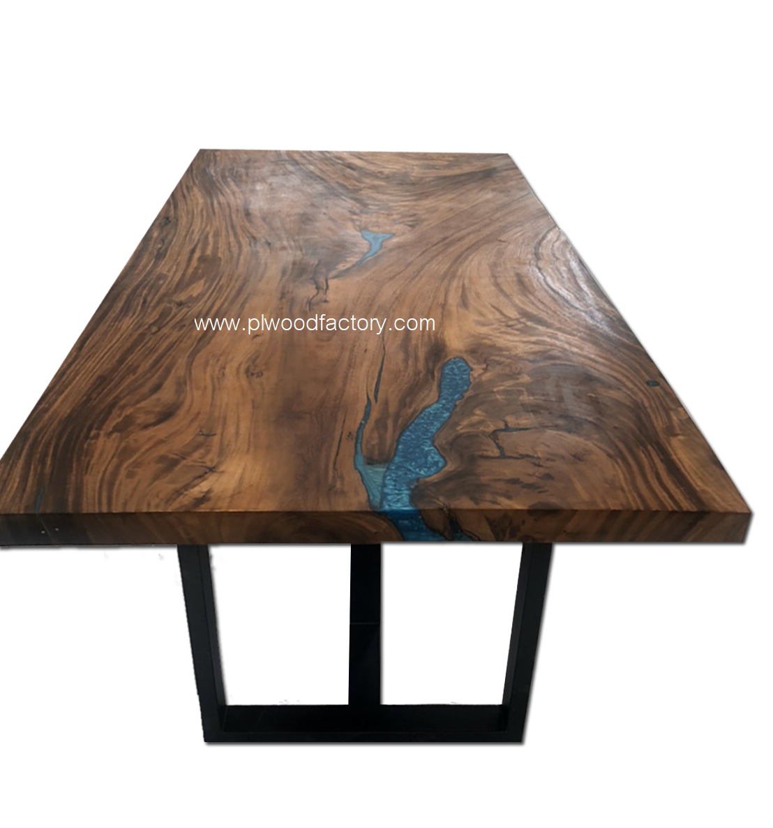 Acacia table with epoxy filled up the wood hole