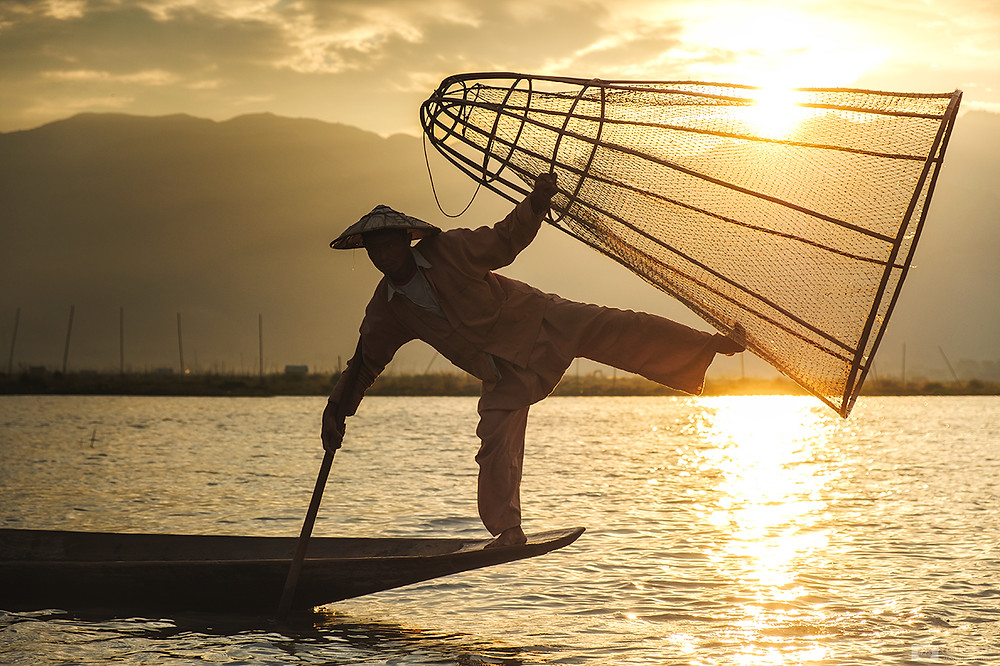 sunrise at lake Inle with fishermen