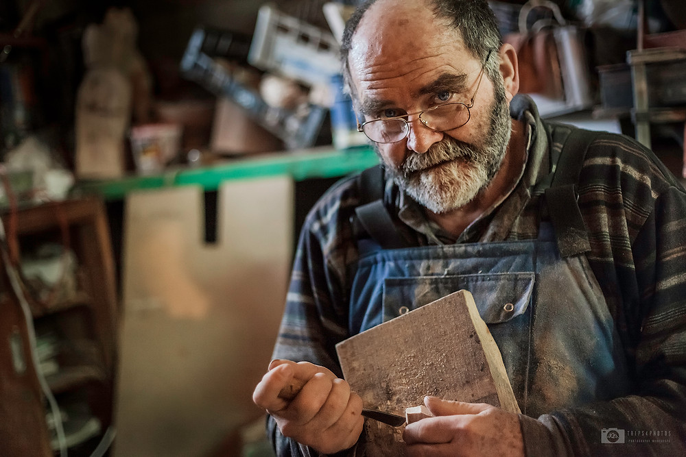 Portrait of the woodmaker in his workshop