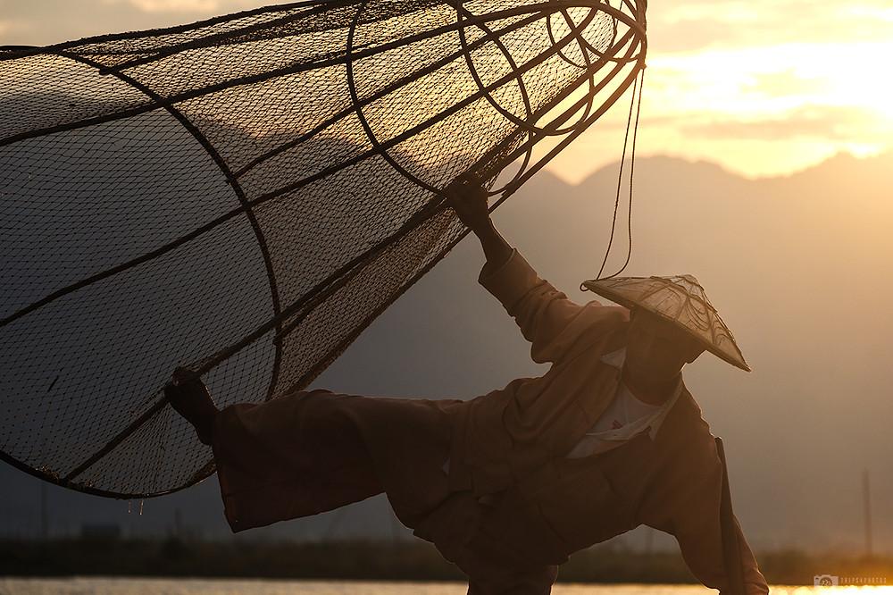 Fisherman on Inle lake at sunrise