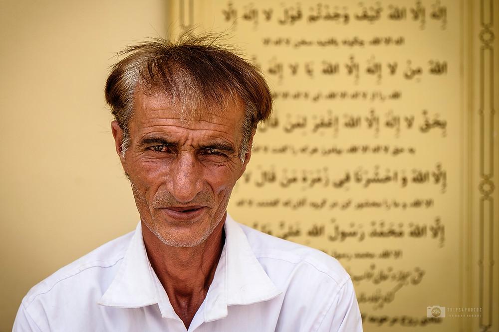 A faithful man is sitting in the Ali ibn Hamze shrine in Shiraz, Iran
