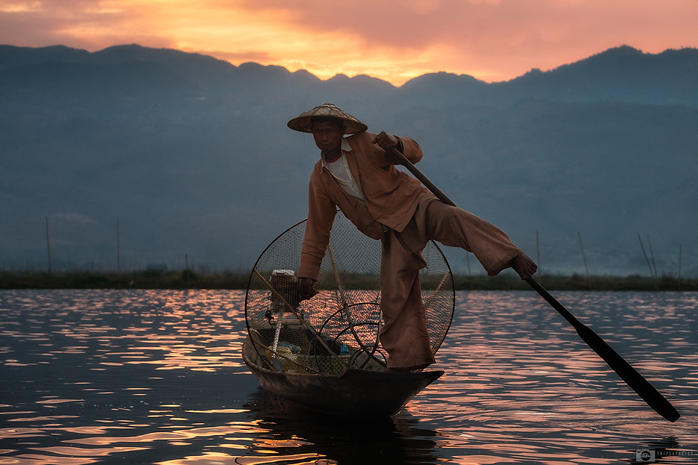Sunrise at Inle lake with fisherman