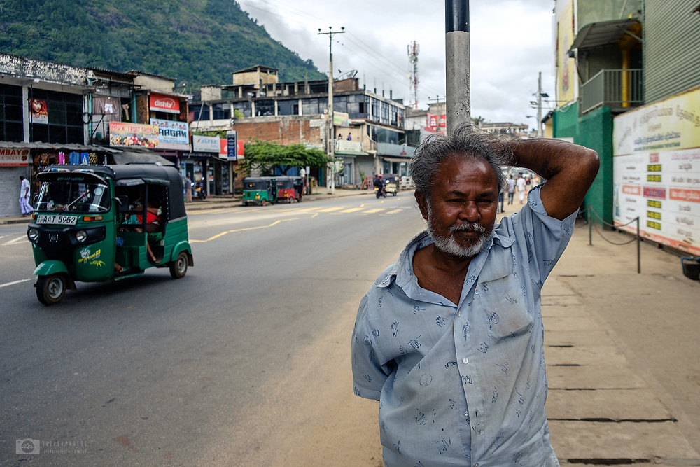 Older man stands on the street in Sri lanka